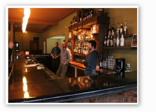 Miles Long, John Joern and Jason Matthews work behind the bar. | Zach Garrison