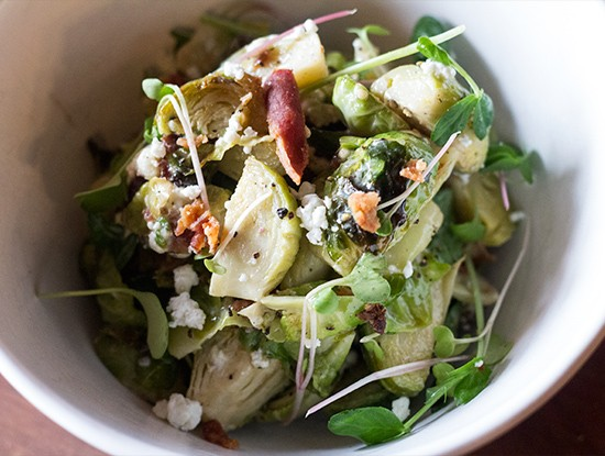 Brussels sprouts salad with bacon, goat cheese and burnt-honey vinaigrette.