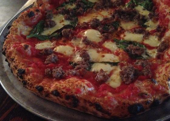 Sausage pizza with mozzarella, tomato and basil. | Nancy Stiles