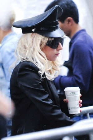 Lady Gaga, on the edge of a glorious Venti latte. - BUZZNET.COM