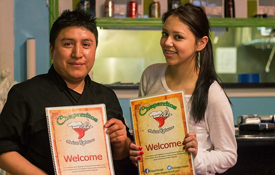 Owner Rafael Marcelino with a Chaparritos employee.