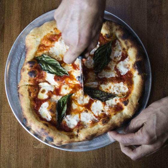 A simple, delicious, margherita pizza, with tomato sauce, mozzarella, basil. | A Pizza Story