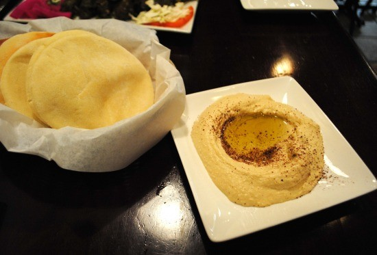Fresh hummus served with warm pita bread - JULIA GABBERT