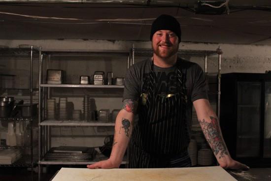 "Chef Jimmy Hippchen in The Crow's Nest's ""prep dungeon."" - MABEL SUEN"