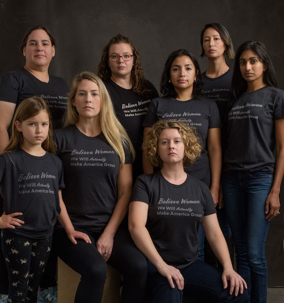 Amanda Gray-Swain, seated center, surrounded by women wearing her T-shirt design. - LINDSEY HINDERER