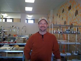 Brian Pelletier behind the counter of Kakao Chocolate's new location on Manchester Avenue in Maplewood. - AIMEE LEVITT