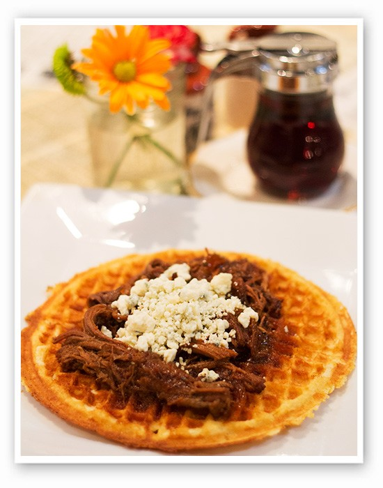 """A """"Blue Ox"""" cornmeal waffle at Melt with caramelized onions, slow cooked brisket, bourbon lime sauce and blue cheese. 