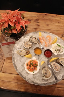 Coastal Bistro and Bar's seafood tasting tower, served on an elevated platter. - MABEL SUEN