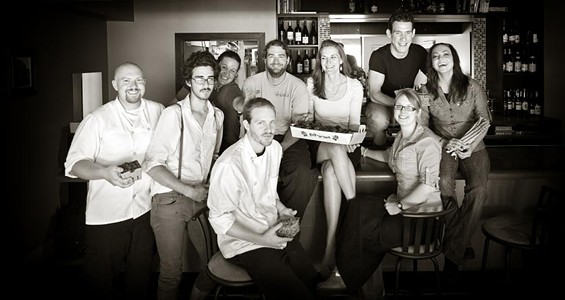 Kevin Willmann (seated, center, on bar) with the front and back of house crews at Farmhaus. - JENNIFER SILVERBERG