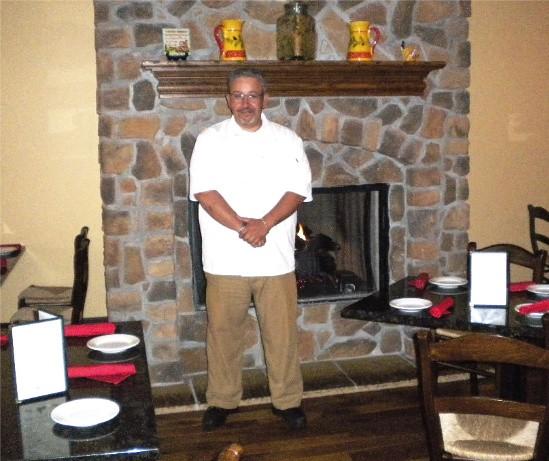 Carretero in Guido's homestyle dining room - DEBORAH HYLAND