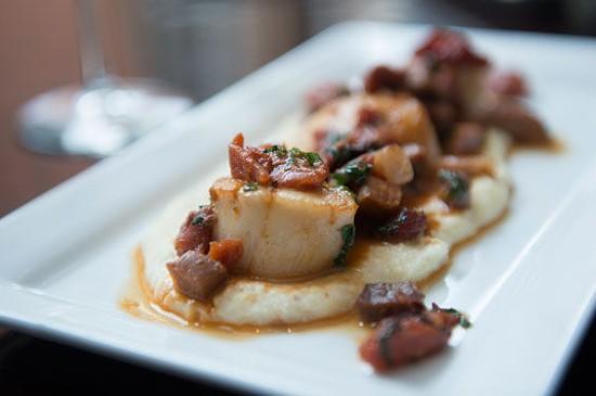 The scallops with ham atop creamy polenta at Robust   Corey Woodruff
