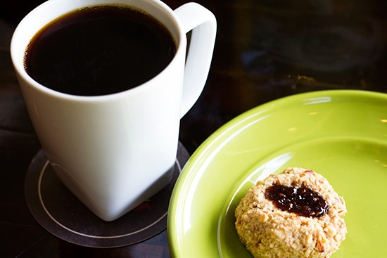 """Malawi Peaberry"" pour-over coffee with a Whisk thumbprint cookie at Kitchen House Coffee. 