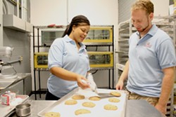 Managing partners Tamika Moore and Jonathan Weinberg in the kitchen - MABEL SUEN