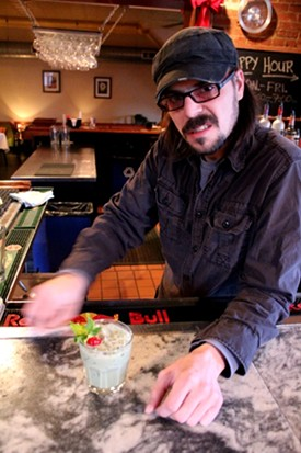 Mangia Italiano bartender Jason Hutto gives Gut Check his best Grinch face. - MABEL SUEN