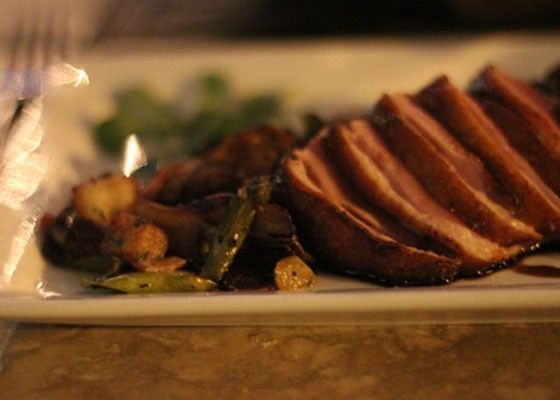 Cherrywood-smoked duck with apple, bacon, asparagus, mushroom, hash and a sherry gastrique at Wild Horse Grill. | Nancy Stiles
