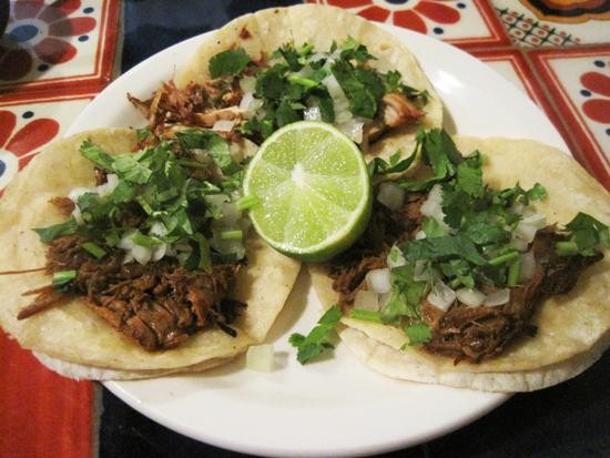 Barbacoa tacos (and a carnitas taco in back) at Tienda El Ranchito - IAN FROEB