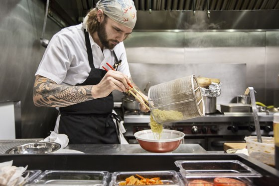 Sous chef Chris Krzysik plating the noodles for the Tonkotsu ramen. | Jennifer Silverberg