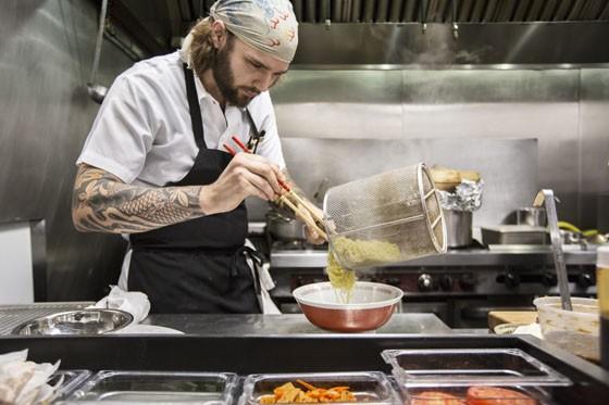 Sous chef Chris Krzysik plating the noodles for the Tonkotsu ramen. | Jennifer Silverberg