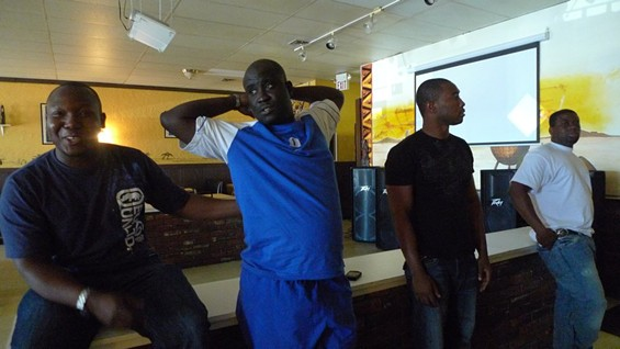 Tam Tam owner Kassim Kone (left) and some of the Ivory Coast contigent - PHOTOS BY KEEGAN HAMILTON