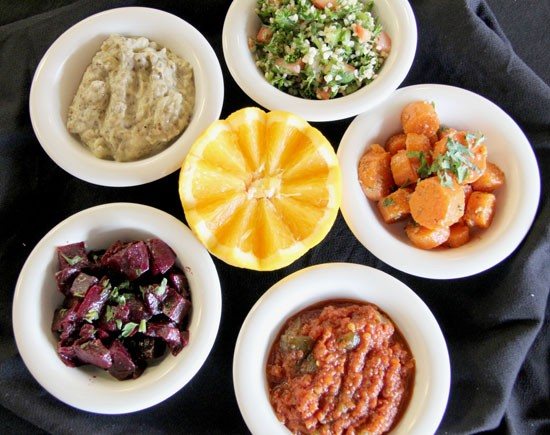 An assortment of Mediterranean salads and dips, including Harir's tabbouleh - KELLY HOGAN