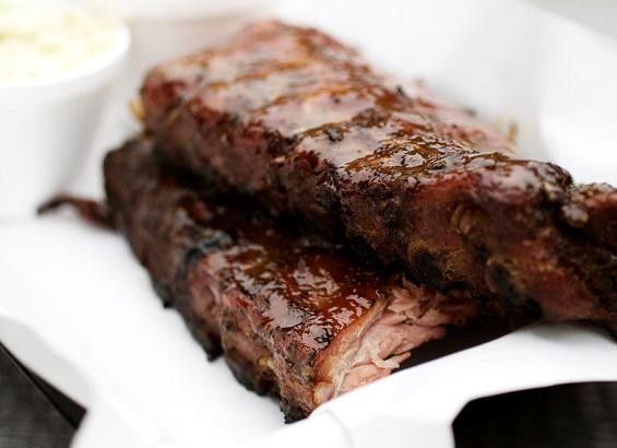 The ribs at Bogart's Smokehouse (wait till you see the torch!) - JENNIFER SILVERBERG
