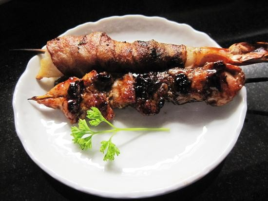 Yakitori tare and a bacon-wrapped shrimp at Izakaya Ren - IAN FROEB