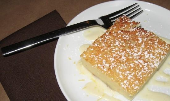 Crustless Buttermilk pie with lemon creme anglaise and lemon zest. - STEPHEN FAIRBANKS