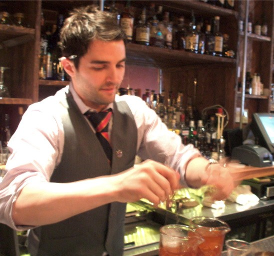 TJ Vytalcil, winner of the Tall Fruit Foward Category, stirring his cocktails. - KRISTEN KLEMPERT