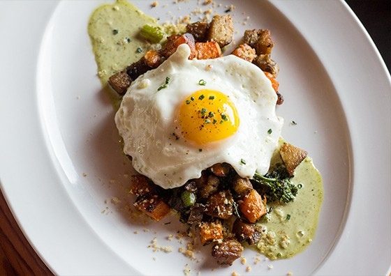"""Hash"" with duck confit, fingerling potatoes, spiced yogurt and egg."