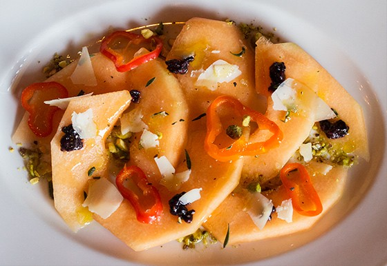 Cantaloupe with pickled cayenne, SarVecchio cheese and pistachio.