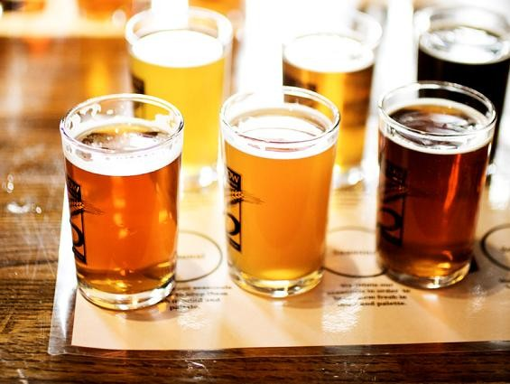 Beer flights at Six Row Brewing Company - JENNIFER SILVERBERG