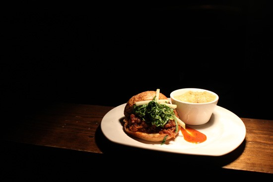 Chef Jimmy Hippchen's pulled-pork sandwich with cilantro barbecue sauce. - MABEL SUEN