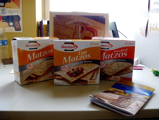 Our four candidates. Front (left to right): Manischewitz 2009, 2011 and 2008. Rear: Matzo Shmuroh. Plus a Maxwell House Haggadah in case anyone had any theological questions. No one did.