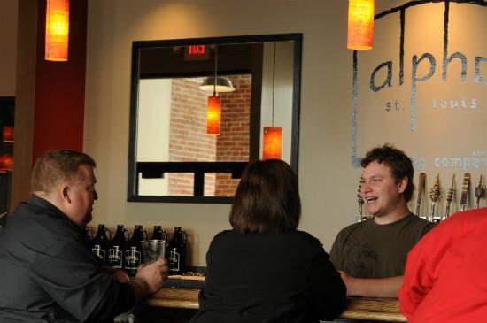 Langeneckert chats with bar patrons. - CAILLIN MURRAY