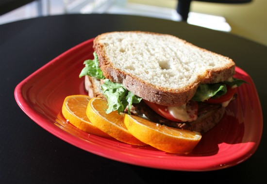 A build-your-own sandwich from Frida's Deli piled high with housemade smoked bacon made with local tempeh, lettuce, tomato and mayo served on gluten-free bread. - LIZ MILLER