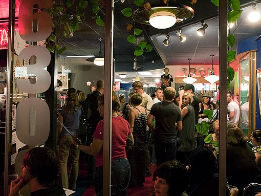 The overflow crowd caused attendees to go into the tattoo shop in groups. - PHOTO: STEW SMITH