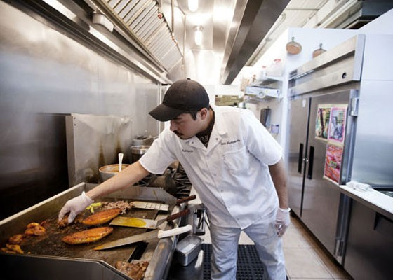 Luis Garcia in the kitchen at Siete Luminarias. | Jennifer Silverberg