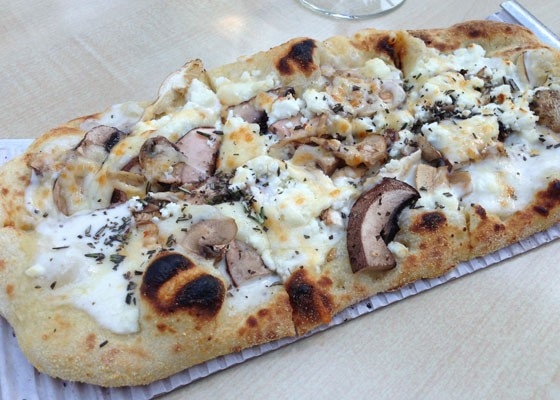 FLATBREAD WITH PARMESAN CREAM, SHIITAKE, PORTABELLA AND WHITE MUSHROOMS, MOZZARELLA AND GOAT CHEESE WITH FRESH ROSEMARY.| NANCY STILES