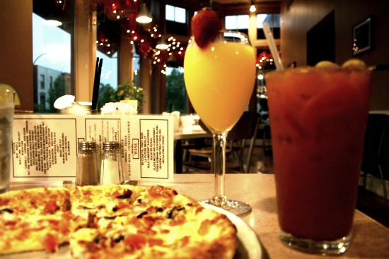 The classic breakfast pizza, mimosa and bloody mary -- three of Benton Park Cafe's house specialties - CHRISSY WILMES