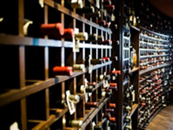 The wine collection at Araka in Clayton - STEW SMITH