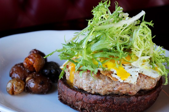 Duck burger on a pumpernickel bun with five-year gouda, a fried duck egg and frisee. - PHOTOS BY MABEL SUEN