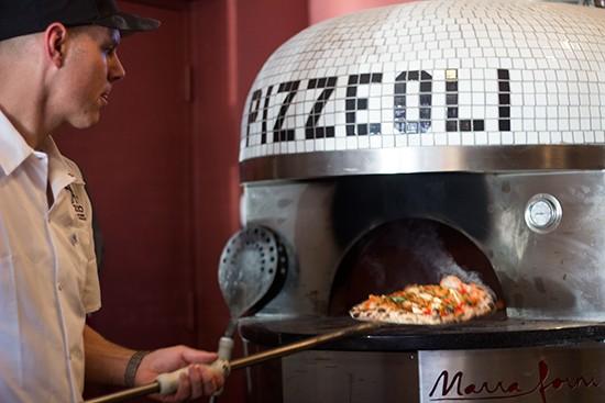 Scott Sandler with Pizzeoli's custom oven. | Mabel Suen