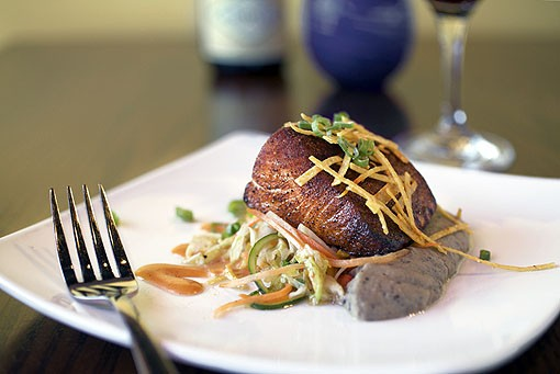 The classic Balaban's small plate of barbecue salmon is served with black bean hummus, warm slaw and tortilla strips. Here it is paired with a Willamette Valley Argyle Pinot Noir. View the full slideshow here. - PHOTO: JENNIFER SILVERBERG