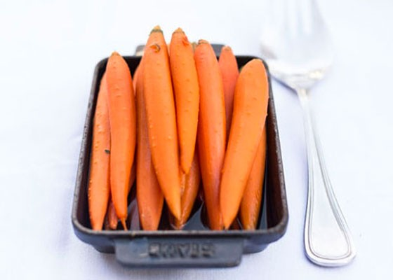 Caramelized baby carrots with a brandy and brown sugar glaze. | Jennifer Silverberg