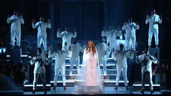 """Beyonce's backup dancers perform the """"Hands up; don't shoot"""" gesture during Bey's rendition of """"Take My Hand, Precious Lord,"""" from the Selma soundtrack. - SCREENSHOT VIA CBS"""
