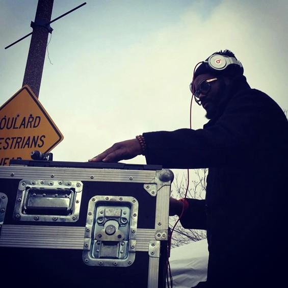 DJ Needles supplies the mix for the breakdancing battles - JON GITCHOFF