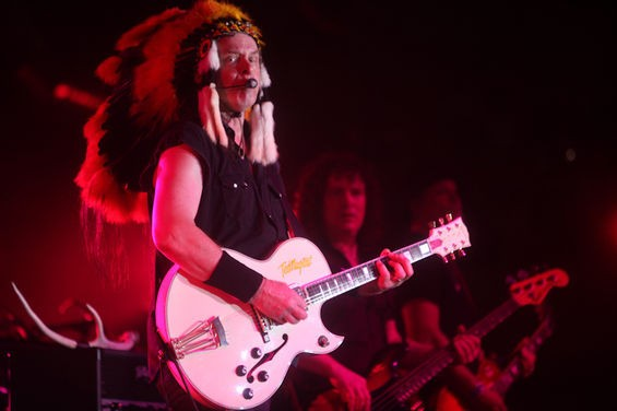 Ted Nugent, wearing a Native American headdress for some goddamn reason. - MARK C. AUSTIN FOR HOUSTON PRESS