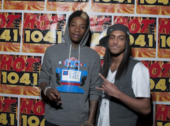 Wiz Khalifa mugging with local rapper Yung Ro in March 2011. - SARAH RUSNAK