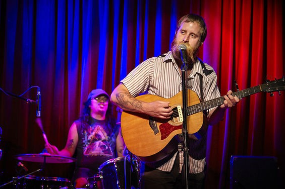 Jack Grelle performs a Saturday matinee at Music Record Shop located between the Ready Room and the Demo in the Grove. - PHOTO BY STEVE TRUESDELL