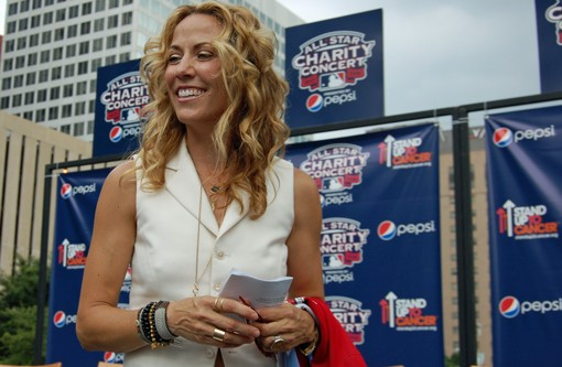 Sheryl Crow on June 22, toting the newly unveiled National League All-Star jersey, in Kiener Plaza in St. Louis. - PHOTO: NICK LUCCHESI